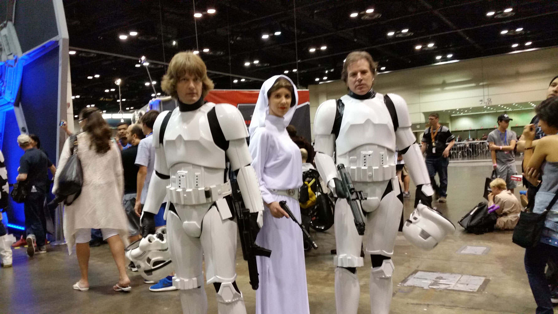 Awesome Luke, Leia and Han cosplay.  They're not short for Stormtroopers.  Haha!
